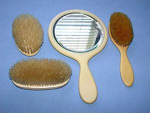 Beautiful-Vintage-Bakelite-Hand-Mirror-and-Three-Brush-Set