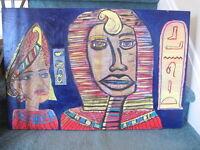 Toile intitulée : Les pharaons 100$ + trépied en bois 100$
