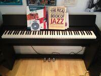 Roland F-110 digital piano £400