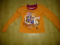 """Girls size """"M"""" orange shirt with decal that says Gypsy Girl"""