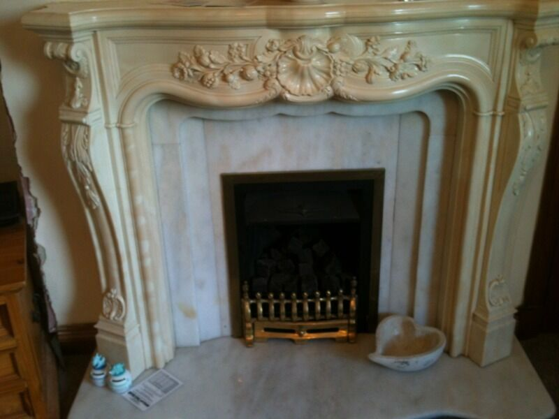 Working gas fire with marble surround