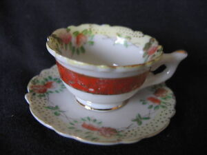 ANTIQUE MINIATURE FLORAL CUP AND SAUCER