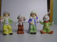 4 Dainty Bisque Clowns