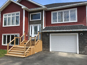 BEAUTIFUL 1 year old Bungalow with 2 garages on 3 acres