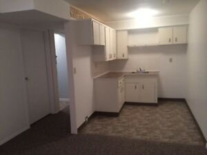 Two bed and den basement suite in lower college heights
