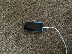 Blue iPhone 5c with charger and case
