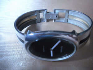 STERLING SILVER WATCH & STERLING SILVER BRACELET .. $155.00 .