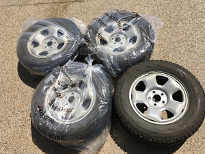 4 Studded Winter Tires with Alloy Rims 245/65R17
