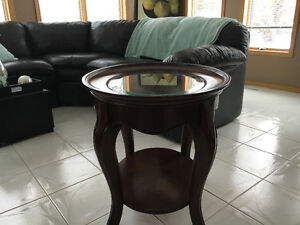 Dark brown wood end table with glass top