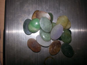 A bunch of pcs of jadeite all different colors