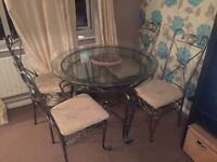 Dining table and 4 chairs from next paid 450 glass table not wood metal frame steel not oak pine