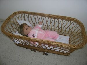 OLD FASHIONED ANTIQUE WICKER BABY BASSINET