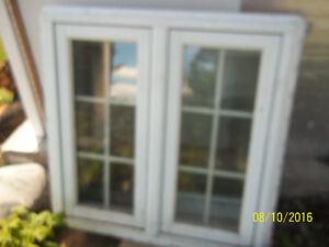 Used, good condition Vinyl clad casement window with wood grills
