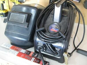 70A 115 volt welder with rods and face mask