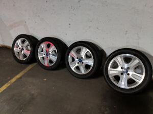 '98-'11 Ford Focus premium alloy wheels with all season tires
