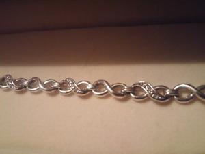 Genuine Sterling silver Diamond .10ctw bracelet- charm