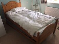 Wooden single bed with trundle pull-out bed and mattresses