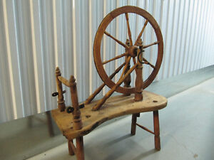 100-year-old portable wooden spinning wheel