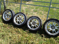 4 Tires with silver lite racing rims for sale