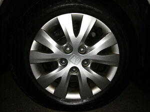 FIRESTONE 15 INCH ALL SEASON TIRES (4)