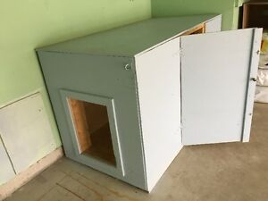 Custom made large fully insulated wooden dog house.