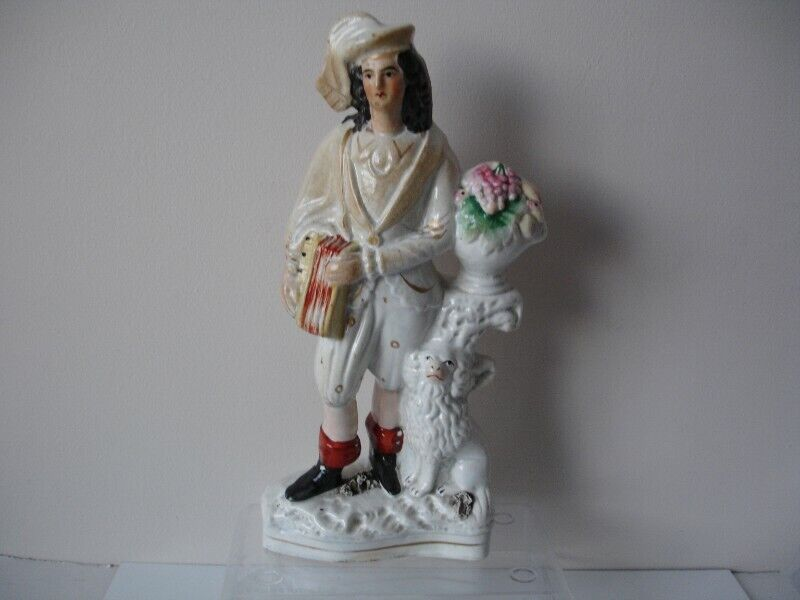 """A 19th Century Staffordshire Figure Musician accordion and dog 10.75"""""""