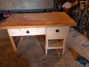Wooden desk with drawers and a cubby