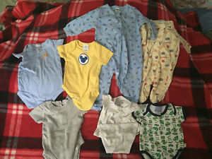 21 pieces of baby boy clothing ranging from 0-3 to 6-9 months