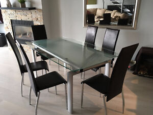 Glass dinning room table and 6 chocloate brown chairs chaises