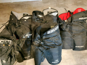 Several Hockey shorts youth med,  junior sm,  med and large