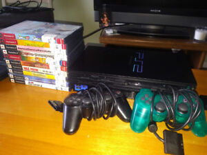 Playstation 2 with two controllers and 10 games