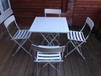 Foldable white metal table and chairs