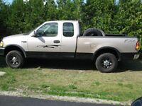Lowered price again 1997 Ford 4WD F-250 + one free F150 4WD
