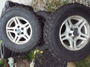 FORD F150 RIMS AND NEW TIRES   265-70-R17