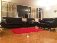 Black Faux Leather Sofa Set :: almost new, very modern styled