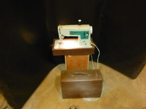 Singer sewing machine model # 337 with wooden carying case