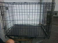 Selling dog cage(cage a chien)- slightly used(for big dogs)