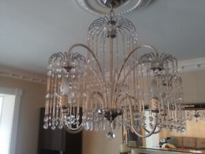 Swarovski chandelier with matching wall fixtures.