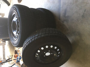 Set of four winter Artic Claw 215/70R16 for sale. $800.00.