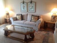 Beautiful 3-piece glass and solid wood coffee table set must go!