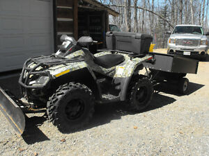 Can-am ATV with plow and garden trailer