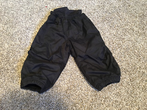 New black snowpants in size 12m from REI