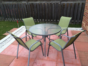 Patio Table and 4 chairs in good condition