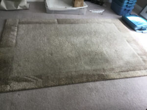 Area rug, beige. Dimensions 62 inches by 91 inches.