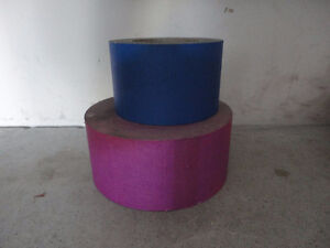 Rolls of hot pink and blue lable stickers