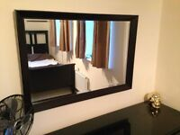 Large faux wood surround mirror