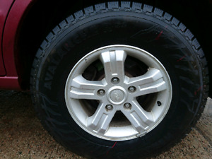 245/70r16 tires and rims off 06 sorento