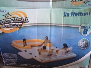 Raft seats 6 people with a cooler