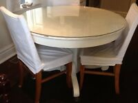 Solid White Pedestal Table with Glass Top