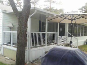 2 bedroom Breckenridge with large screen room and hard roof.